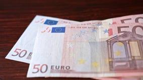 Куча 50 банкнот евро на таблице Стоковые Изображения RF