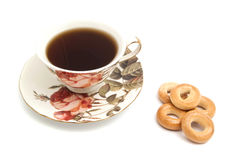 Куча бейгл и чашки чаю Стоковые Изображения