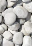 Куча белых камней для предпосылки или текстуры Стоковое Фото