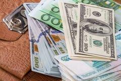 Куча бумажных денег на портфеле Стоковое Изображение RF