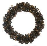 Куча горячих изолированных семян черного перца Стоковые Фото
