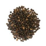 Куча горячих изолированных семян черного перца Стоковое Фото
