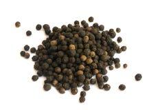 Куча горячих изолированных семян черного перца Стоковая Фотография RF