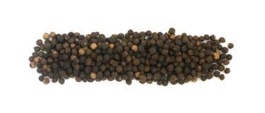 Куча горячих изолированных семян черного перца Стоковое Изображение