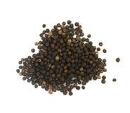 Куча горячих изолированных семян черного перца Стоковые Изображения