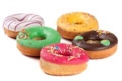 Куча застекленных donuts изолированных на белой предпосылке Стоковые Фото
