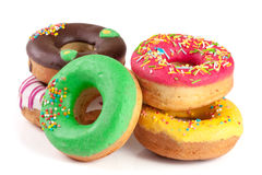 Куча застекленных donuts изолированных на белой предпосылке Стоковое Изображение RF