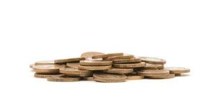 Куча золотых монеток на белой предпосылке Стоковая Фотография