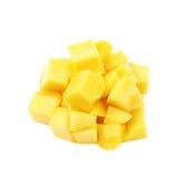 Куча изолированных кубов плодоовощ манго Стоковое Изображение