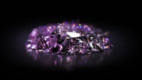 Куча камней драгоценности в фиолетовый вращать тонов сток-видео