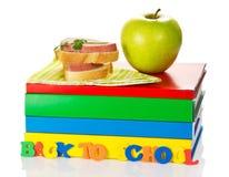 Куча книг и сандвича Стоковое Изображение