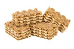 Куча коричневых вафель на белизне Стоковое Фото
