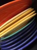 Куча красочного круга dishes предпосылка Стоковое Изображение RF