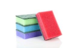 Куча красочного размывателя губки над белой предпосылкой Стоковое Фото