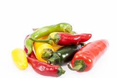 Куча красочного сырцового перца chili на белой предпосылке Стоковые Фотографии RF