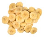 Куча кусков банана на белизне Стоковые Фотографии RF