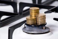 Куча монетки на газовой горелке Стоковое Фото