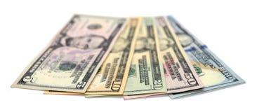 Куча долларовых банкнот изолированных на белой предпосылке Стоковое Изображение