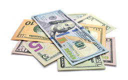 Куча долларовых банкнот изолированных на белой предпосылке Стоковые Фотографии RF