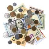 Куча долларовых банкнот и монеток изолированных на белой предпосылке Стоковая Фотография RF