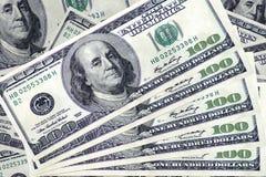 Куча 100 долларов дизайна как предпосылка Стоковое Фото