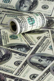 Куча долларов крена как предпосылка Стоковое Изображение