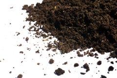 Куча почвы изолированная на белой предпосылке Стоковое Фото