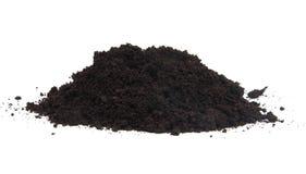Куча почвы черного сада верхней над белой предпосылкой Стоковые Фотографии RF