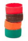 Куча пластичных крышек бутылки ЛЮБИМЧИКА Стоковое Изображение RF
