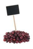 Куча плода шиповника с указателем для вашего текста Стоковое Изображение