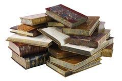 Куча старых книг изолированных на белизне Стоковое фото RF
