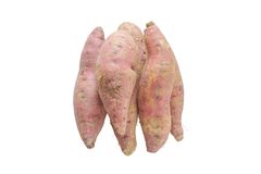 Куча сырцового сладкого картофеля изолированного на белой предпосылке Стоковое Фото