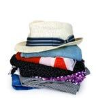 Куча цветастых одежд с шлемом стоковая фотография rf