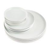 Куча чистых белых изолированных плит тарелки Стоковые Фотографии RF