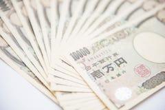 Куча японца 10 тысяч банкноты иен Стоковые Изображения RF