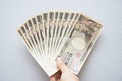 Куча японца 10 тысяч банкноты иен Стоковые Фотографии RF