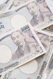 Куча японца 10 тысяч банкноты иен Стоковое Изображение
