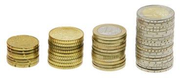 Кучи монеток поднимая более высоко Стоковое фото RF
