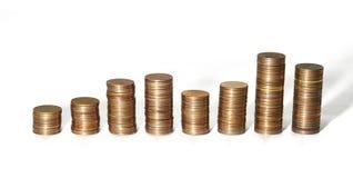 Кучи монеток различной высоты Стоковая Фотография RF