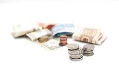Кучи монеток стоковые изображения