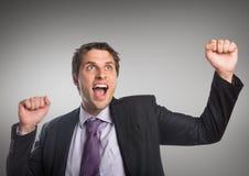 Кулаки бизнесмена в воздухе против серой предпосылки Стоковые Фотографии RF