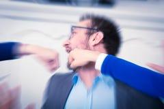 Кулаки пробивая бизнесмена в стороне стоковые изображения