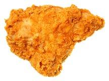Кудрявая куриная грудка жареной курицы изолированная над белизной Стоковое фото RF