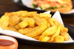 кудрявые fries франчуза Стоковая Фотография RF