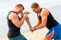 Культуристы на пляже Стоковое фото RF