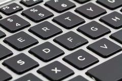 Клавиатура компьтер-книжки с черными ключами closeup Стоковое Изображение