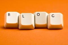 Клавиши на клавиатуре блога белые на апельсине Стоковые Фотографии RF