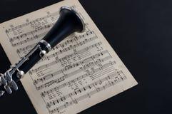Кларнет колокол и ноты стоковое изображение
