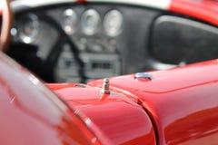 Классическая красная деталь гоночного автомобиля Стоковые Фотографии RF