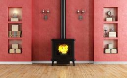 Классическая красная комната с камином Стоковые Фотографии RF